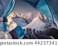 Group of climber are inside a tent with open 44237341