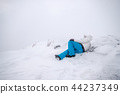 Man mountaineer wearing snow coat with relaxing 44237349