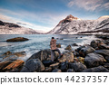 Seascape with snow mountain and photographer 44237357