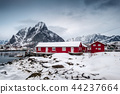 Snowfall on red house with harbor in valley 44237664