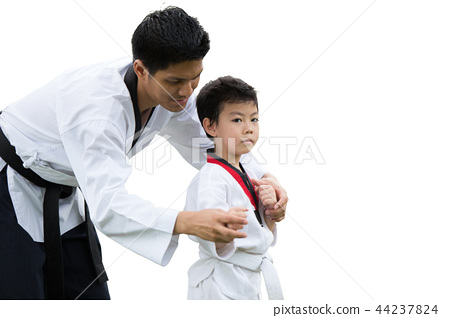 Taekwondo master black belt teaching kid 44237824