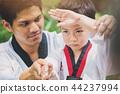Taekwondo master black belt teaching kid 44237994