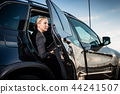 Businesswoman sitting in car 44241507