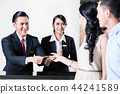 Employees of a hotel welcomes young couple 44241589
