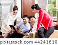 Business people looking at digital tablet 44241610