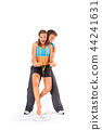 Young man lifting woman above weighing scale 44241631