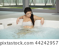 woman relaxing at spa club 44242957