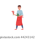 Florist holding small bunch of flowers and green leaves. Young man in red apron. Worker of flower 44243142
