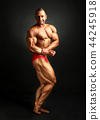 Studio shot of male bodybuilder posing, 44245918