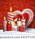 Christmas still-life with candles and decorative 44247139