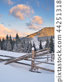 Winter landscape with a fence 44251318
