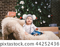 Subject children christmas new year. Caucasian little funny baby boy 1 year old sitting sleigh bear 44252436