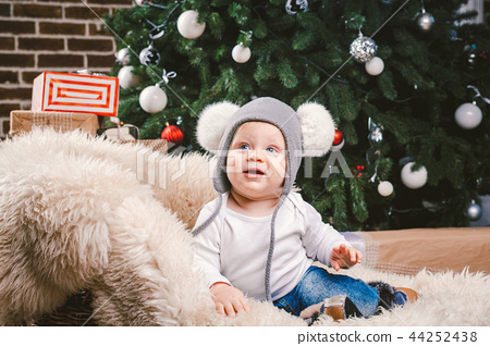 Subject children christmas new year. Caucasian little funny baby boy 1 year old sitting sleigh bear 44252438