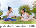 Girls happiness funny soap bubble in the park  44253807