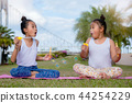 Happy time two girl sister play soap bubble  44254229