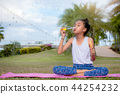 Girls happiness funny soap bubble in the park  44254232