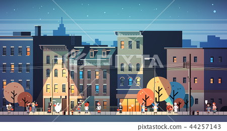 kids wearing monsters costumes walking night town holiday concept cityscape background tricks or 44257143