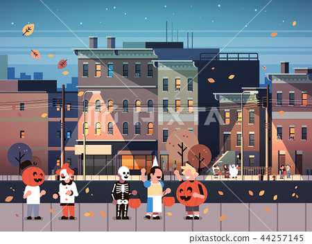 kids wearing monsters costumes walking night town holiday concept cityscape background tricks or 44257145