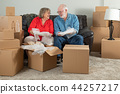 Senior Couple Surrounded By Moving Boxes 44257217
