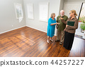 Real Estate Agent Shows Senior Couple A New Home 44257227