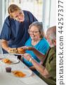 Nurse Serving Senior Couple Lunch at Nursing Home 44257377