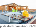 Construction Workers with Drone Inspect Job Site 44257929