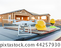 Construction Workers with Drone Inspect Job Site 44257930