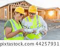 Construction Workers with Drone Inspect Job Site 44257931