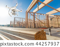 Drone Quadcopter Flying and Inspecting Construction Site 44257937