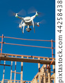 Drone Flying and Inspecting a Construction Site 44258438