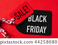Black Friday Sale text on a red and black tag. 44258680