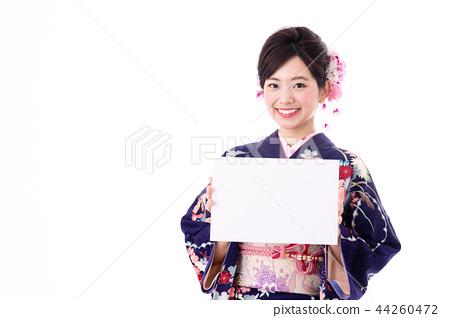A woman in a kimono 44260472