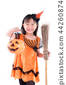 Little girl wearing witch costume with broom 44260874