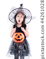 little girl wearing witch costume for Halloween  44261028