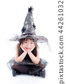 little girl wearing witch costume for Halloween 44261032