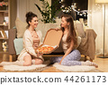 happy female friends with pizza at home 44261173