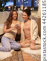 happy female friends with smartphone at home 44261185