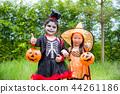 Little girls in Halloween costume in park  44261186