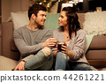 happy couple drinking coffee and eating at home 44261221