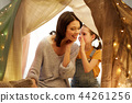 happy family whispering in kids tent at home 44261256