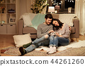 happy couple with cat at home 44261260
