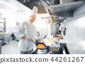 happy male chef cooking food at restaurant kitchen 44261267