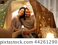 happy couple in kids tent at home 44261290