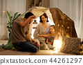 happy family playing in kids tent at night at home 44261297