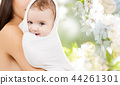 close up of mother with baby in bath towel 44261301