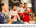 friends celebrating christmas and drinking wine 44261572