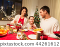 happy family having christmas dinner at home 44261612