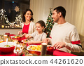 happy family having christmas dinner at home 44261620