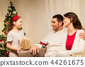 happy family with christmas present at home 44261675