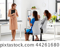 business team applauding to woman at office 44261680